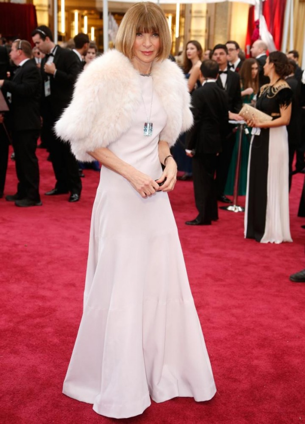 Anna Wintour. Nice. And the necklace freshed it up big time. And is that the try for a smile? Awwm.